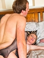 Hot MILF playing with a younger dude